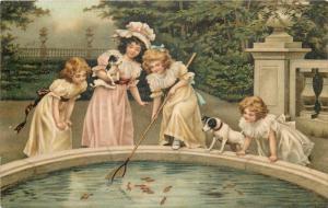 Edwardian girls fish pond puppies dogs fantasy vintage postcard 1900s