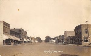 Dunlap Iowa~Main Street~Bank~Livery & Undertaking~Man on Huge Crate~c1912 RPPC