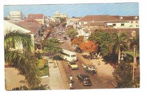 Busy little Bay Street, main street of Nassau in the Bahamas, 40-60s
