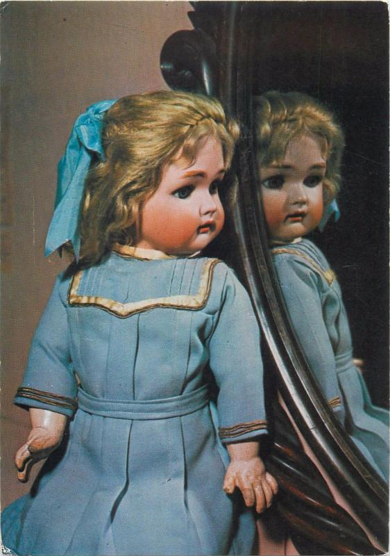 Postcard = an early Edwardian doll toy