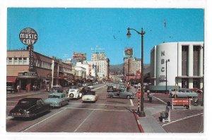 CA Hollywood Sunset Blvd and Vine Radio Center NBC Music City Cars Vntg Postcard