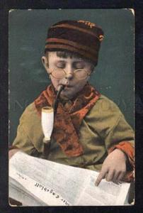 025461 Boy SMOKING Tobacco Pipe. Glasses reading NEWSPAPER old
