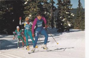 Mt. Washington Ski Resort Ltd., Skiers on snowcapped peaks of Strathcona Park...