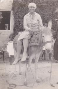 RP; Woman riding side saddle on donkey, 10-20s