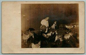 RPPC Toddler Boy Feeds Chicken in Barn From Bucket Of Field Corn~c1906 Postcard