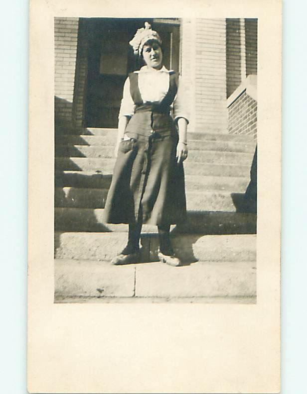 Pre-1920 rppc WOMAN IN BONNET ON STEPS OF BROWNSTONE APARTMENT r6466