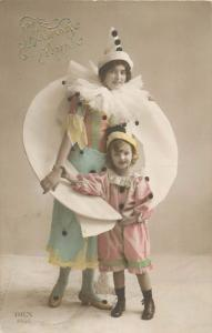 Charming young lady & girl harlequin costumes vintage tinted postcard