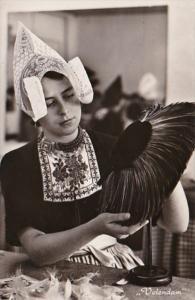 Netherlands Volendam de Gouwe Deken Workshop Girl Making Feather Hat Photo
