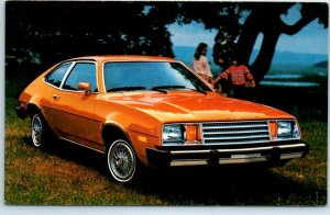 1980 FORD PINTO Advertising Postcard Bright Orange 2-Door Car / Outdoors Unused