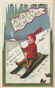 NEW YEAR; A Happy New Year, Boy sliding down snow, sled holding banner, PU-1910