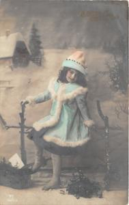 Girl in Teal Winter Coat Posing on Wood Fence~Christmas Greeting~1912 RPPC NYC