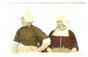 Two Woman dressed in traditional outfit, Volendam, Noord-Holland, Netherlands...