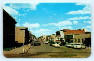 Postcard WY Rawlins Cedar Street Business District c1950s Old Cars #2 J10