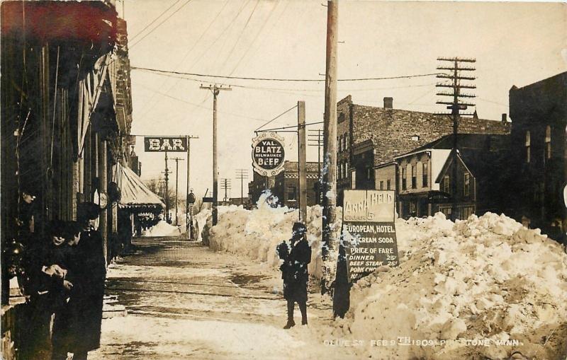 Pipestone MN~Olive St~Art Nouveau Blatz Sign~Held Cigar~Snow Drifts 1909 RPPC