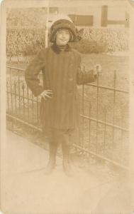 RPPC Girl w/Knit Hat & Single-Breasted Coat, Holds onto Wrought Iron Fence~c1919