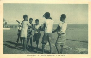 New Caledonia Loyalty Islands Province ethnic boys making rope