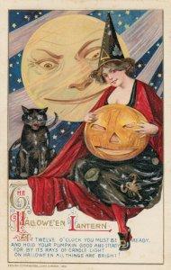 HALLOWEEN , 1912 ; Woman hugging a Jack O'Lantern , Black cat ; WINSCH