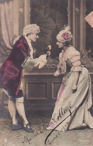Man offers flowers to woman, PU-1904