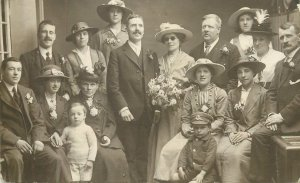 Postcard elegant ladies and gentleman extended family group photo