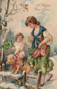 NEW YEAR, 1907; Child riding pig while collecting shamrocks,  PFB 7104