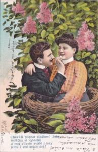 Romantic Couple Sitting In Basket Chces-li poznat sladkost 1907