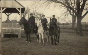 Young Men Wearing Newsboy Hats on Horses c1910 Real Photo Postcard