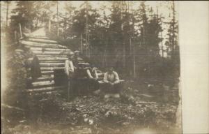 Log Cabin Logging Camp & Men Bangor ME on Back Real Photo Postcard