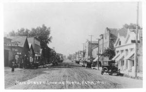 Alma Wisconsin~Main Street North~Miller's Garage~Vintage Cars~Dirt Road~RPPC