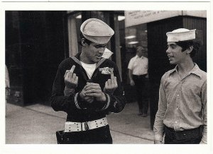 Sailor Holding The Finger Statuettes in Times Square NYC 1975 Postcard
