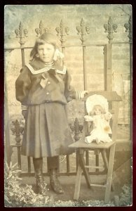 dc1643 - ENGLAND 1910s Girl with her Toy Doll. Real Photo Postcard
