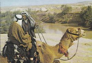 Two Men riding camels toward the Jordan River, Israel, 50-70s