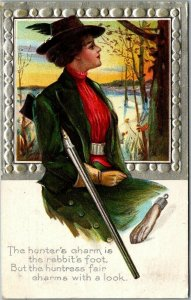1910 Greetings Postcard WOMAN WITH RIFLE Hunter's Charm is the Rabbit's Foot…