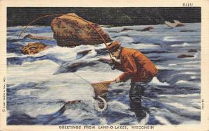 Land O' Lakes Wisconsin~Fisherman in Thigh Waders Nets Fish~1949 Linen Postcard