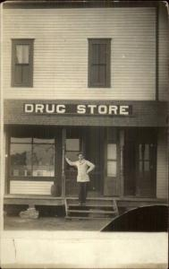 Man Standing in Front of Drugstore DRUG STORE Sign c1910 Real Photo Postcard