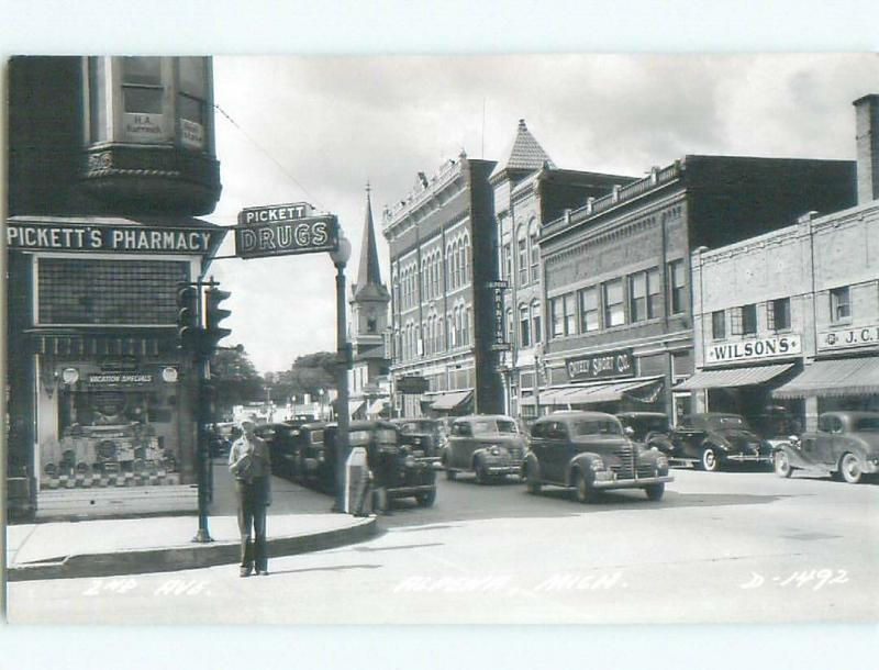 Pre-1950 rppc SHOPS ALONG STREET Alpena Michigan MI W0206