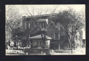 SIDNEY NEBRASKA TAYLOR HOSPITAL 1950's CARS VINTAGE B&W POSTCARD