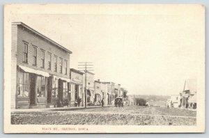 Ireton Iowa~Main Street Storefronts~Men on Sidewalk~Wagon~Rutted Dirt Road~1909