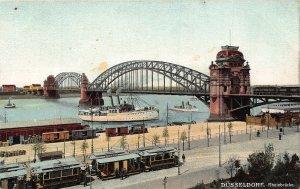 Dusseldorf Rheinbrucke Bridge River Boats Tram Postcard