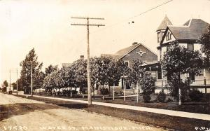 Manistique MI Dirt Rd by Nice Homes on Water St (Arbutus Ave) Turret RPPC 1913
