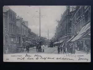 Wales CARDIFF Queen Street showing SHAVING PARLOUR, TRAMS used c1902 UB Postcard