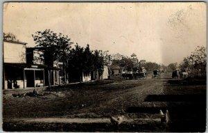 HEPLER, Kansas RPPC Real Photo Postcard Main Street Downtown Scene 1915 Cancel