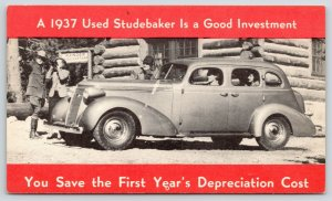 A 1937 Used Studebaker Is Good Investment~Log Cabin~Binoculars Lady~Advertising