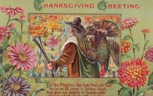 THANKSGIVING; 1910 ; Greeting, Pilgrim with gun and bagged turkey ; EMBOSSED