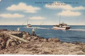 Florida Deep Sea Fishing Cruisers Passing Fishermen On The Jetties Curteich