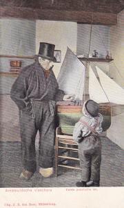 Dad & Son Looking At A Small Play Sailboat, Netherlands, 1900-1910s