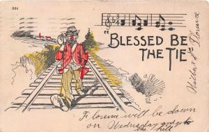 BLESSED BE THE TIE...HOBO WALKING DOWN RAILROAD TRACKS COMIC POSTCARD 1905