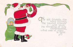 CHRISTMAS, 00-10s; Santa Claus putting up wreath, Bag of toys, Doll, Bonnet
