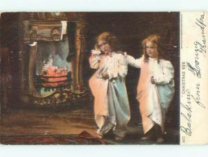Pre-1907 TWO GIRLS IN NIGHTGOWNS ON CHRISTMAS EVE BY FIREPLACE o3237