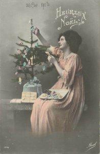 Christmas greeting early 1900s Postcard lady decorating Christmas tree