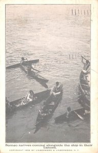 Borneo natives coming alongside the ship in the canoes Indonesia, Republik In...